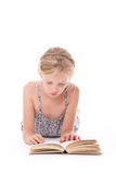 Young girl reading a book against white background Stock Photos