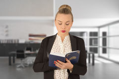 Young girl reading a book. Beautiful young woman holding a book in his hands Stock Photography