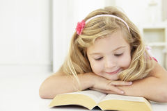 Young Girl Reading Book In Bedroom Royalty Free Stock Photography