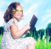 Young girl reading book. Royalty Free Stock Photos