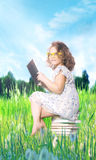 Young girl reading book. Stock Photography
