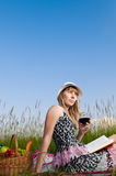 Young girl reading book and drinking wine Royalty Free Stock Photo