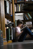 Young Girl Reading Book In Library Royalty Free Stock Photography