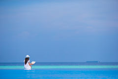 Young girl reading book near swimming pool Royalty Free Stock Image