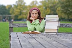Young girl reading a book in a park Royalty Free Stock Photo
