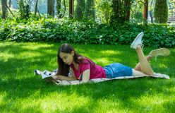 Young girl in a picturesque park royalty free stock image