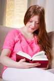 Young girl reading a book Stock Photos