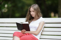 Young girl reading book Royalty Free Stock Image