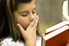 Young girl reading books Stock Images