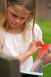 Young girl reading magazine Royalty Free Stock Photo
