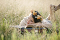 Young girl reading and meditating. Young girl meditating reading and relaxing in nature stock photography