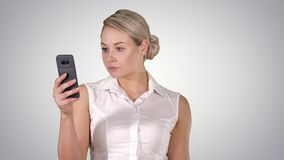 Young girl reading from mobile phone screen, alpha channel stock footage