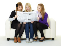 Young girl reading newspaper Royalty Free Stock Photos