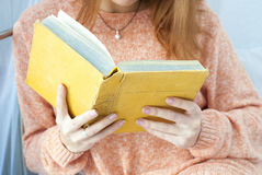 Young girl reading an old book Stock Photo