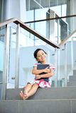 Young Girl Reading On The Stair Stock Images