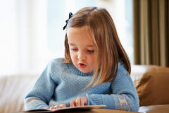 Young Girl Reading Story At Home Royalty Free Stock Images