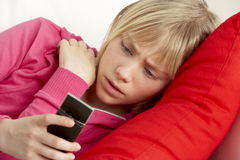 Young Girl Reading Text And Looking Worried stock image