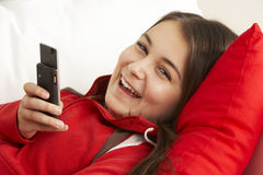 Young Girl Reading Text Message Royalty Free Stock Photography