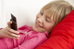Young Girl Reading Text Message Royalty Free Stock Images