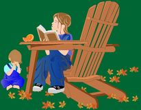 A Young girl reading to her brother... Stock Photo