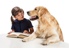 Young girl reading to her dog Royalty Free Stock Photography