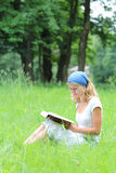 Young girl reads the Bible Stock Images