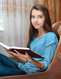 Young girl reads book Royalty Free Stock Photography