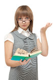 Young girl reads english and is amazed Royalty Free Stock Photos
