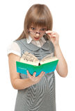Young girl reads english and wonders. On white background Royalty Free Stock Photos
