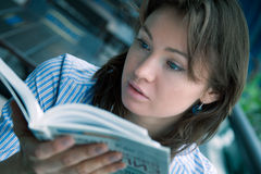 Young girl reads the interesting book Stock Image