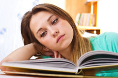 The young girl reads the textbook Royalty Free Stock Image