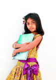 Young girl, ready to learn. Asian Indian girl in a colorful skirt posing with a big encylopedia book royalty free stock images