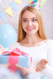 Young girl receives birthday gift Royalty Free Stock Image