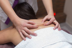 Young girl receiving back relaxing massage Royalty Free Stock Photos