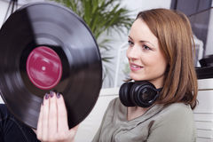 Young girl with records in her hand Stock Photography