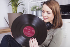 Young girl with records in her hand Royalty Free Stock Images
