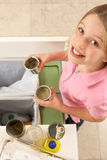 Young Girl Recyling Waste At Home Stock Image