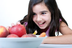 Young girl with red apple Stock Photos