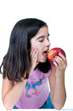 Young girl with red apple Stock Image