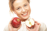 Young girl with a red apple in hand Stock Photography
