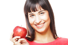 Young girl with a red apple in hand Stock Photos