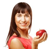 Young girl with a red apple in hand Stock Images