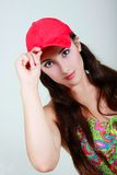 Young girl in red cap Royalty Free Stock Photo