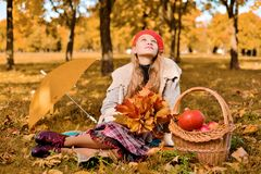Young girl in red cap is sniffing looks romantic up stock images