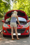 A young girl with a red car Stock Photo