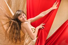 Young girl in a red cloth Stock Photos