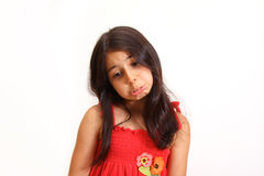 Young girl in red dress Stock Image