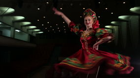 Young girl in a red dress dancing folk dance. stock video