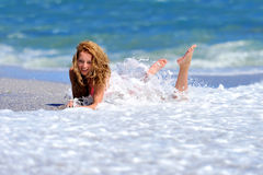 Young girl on the ocean coast Stock Photography