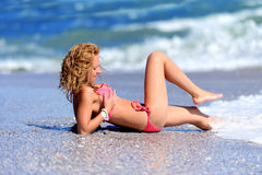 Young girl on the ocean coast Royalty Free Stock Photography
